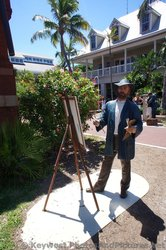 Front view of Artist painting statues at Key West Custom House Museum grounds.jpg