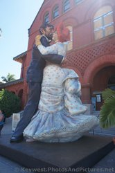 Statues of Man and Woman Dancing in front of Key West Customs House Museum.jpg