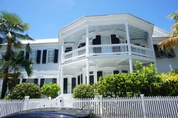 White home with second story porch in Key West.jpg