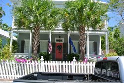 Two Story Home with second story porch & red door in Key West.jpg